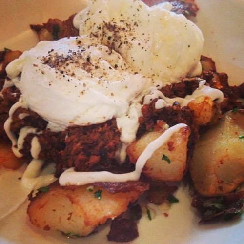 Poached eggs + chorizo potatoes. #hotlikefire  (at Don Pisto's)