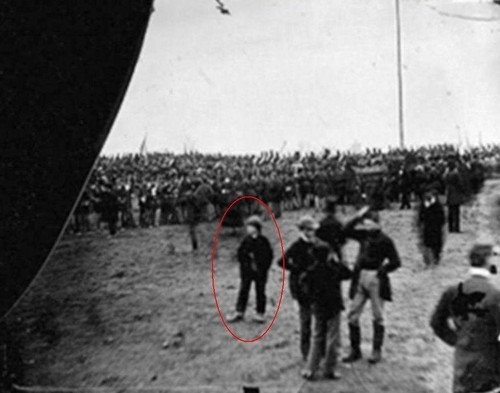 "This Man States He Is A Time Traveler and Is In The Picture Of The Gettysburg Address ""Andrew D. Basiago, 10, at Gettysburg, PA, on November 19, 1863, after being sent there from 1972 by DARPA's Project Pegasus via a ""plasma confinement chamber"" in East Hanover, NJ. Andy is the boy standing to the left in the foreground of the image. He is wearing the large shoes that were given to him by Gettysburg cobbler John Burns after he walked into Gettysburg barefoot and shivering in the brisk autumn air after arriving from the future. Andy says that this image was taken shortly after President Lincoln arrived on the dais to deliver the Gettysburg Address."" He said that he was a part of a group of kids from the 60's and 70's that participated in this time travel. It was a DARPA project called Project Pegasus. Some form of teleportation project. Basiago stated that the knowledge of the future was used to alert future US presidents including both of the Bush's and Barack Obama.  Basiago said that met future President Barack Obama in 1982 when he was attending UCLA and Obama, then a student at Columbia University, was visiting former classmates at Occidental College in Los Angeles. Basiago claimed that Obama, then age 20, already knew that he would one day be president. Basiago also said that in 1972 he was rewarded for his good work at DARPA by being sent back in time via a wormhole to 1863 to witness Lincoln's historic Gettysburg Address speech."