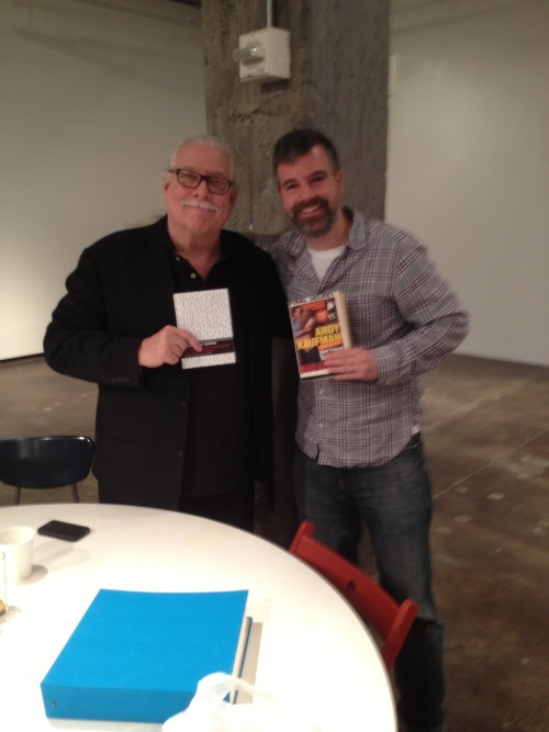 "charlietodd:  I met Bob Zmuda yesterday at a gallery show featuring letters and artifacts from the life of Andy Kaufman.  Bob was Andy's writing partner.  Part of the concept of the show is that each day a member of Andy's ""inner circle"" is in the gallery sitting at a table, and you're encouraged to sit and chat with them.  It was an absolute thrill to meet Bob.  His book, Andy Kaufman Revealed, was one of the main inspirations for Improv Everywhere.  My buddy Ken Keech gave me a copy in college, and it was definitely a life-changing book for me.  I've enjoyed pranks my entire life, but this book opened my eyes as to what was possible.  Bob and Andy pulled off pranks that were both meticulously planned and largely improvised.  One stunt in the book was the direct inspiration for our old Amazing Hypnotist prank.  We pretty much copied it beat for beat. So it was really exciting to get to meet Bob in person and thank him.  We chatted about his adventures with Andy, and I shared a few stories of Improv Everywhere's greatest hits.  He signed my book (""Charlie, Keep them guessing!! - Bob Zumda"") and then disappeared for a few minutes.  When he returned, Tony Clifton had signed the book as well! (""Charlie, Go fuck yourself!! - Tony Clifton"") I gave him a copy of Causing a Scene, and thanked him again for all the inspiration.  The Kaufman show ends on Saturday.  Details here.  This is the coolest. I highly recommend checking out this Andy Kaufman gallery show! I wrote a little thing about it for the NY Post."