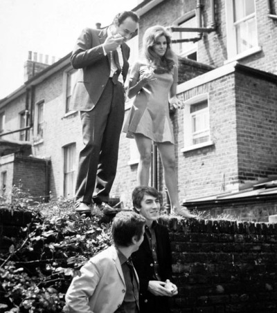 ontheset:  Director Stanley Donen, Dudley Moore, Peter Cook and Raquel Welch during filming of Bedazzled