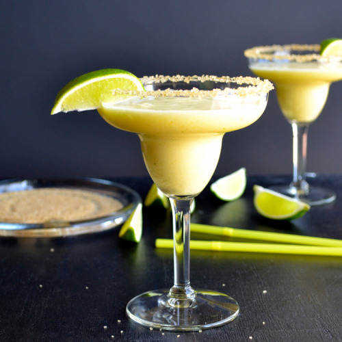 itspartyrehab:  Frozen Pineapple MargaritaIngredients & Measurements: 2 cups Frozen Cut Pineapple 1 cup Orange Juice 2 tbsp Honey Juice of 1 Lime 1/2 cup Tequila 1 tbsp triple Sec Sugar Lime Wedge Instructions:Put all ingredients into the blender. Blend on high speed for about one minute. If you'd like to rim the glasses with the sugar, fill one shallow dish with water and one with some sugar in it. Dip the glass into the water. Let the excess drip off, then dip into the sugar. Pour the margarita into chilled margarita glasses and garnish with a wedge of lime.