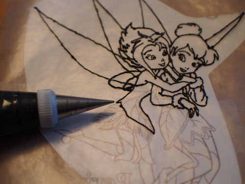 I don't know how I ended up specializing in frozen buttercream transfers, but now I'm tracing Tinkerbell and her sister (huh?) with a size 0 tip.  My hands shake like crazy and I have very little patience or tolerance for tedious tasks - how did I end up being good at this??