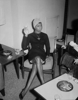 nina simone in 1965, turban, black dress and cigarette