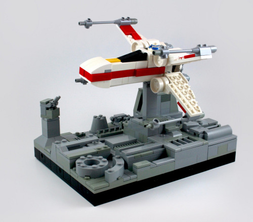 Micro X-Wing flying over the surface of the Death Star, by MacLane. I love the detail in this shot. The 2x2 smooth round hatch piece is one of my favorites.
