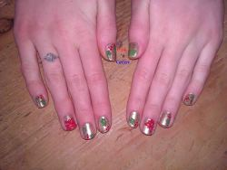 Did my other sisters nails back in December. Poinsettias and holly.