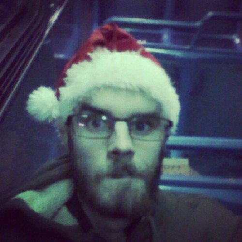 #Christmas colors! Heading home from #work on the #bus. #MerryChristmas #ChristmasEve #Beard #SantaHat #Mustache #glasses #theexiledleader