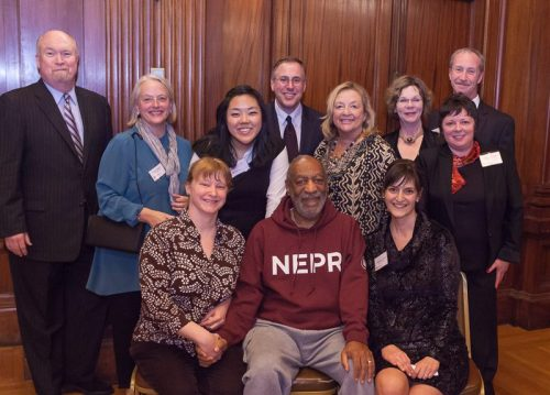 "Dr. Bill Cosby with the staff of NEPR.   Quite frankly, Bill Cosby is a crank and thoroughly insane. His schtick is so wearisome that I tune out my local NPR station because they call upon him way too much to help raise funds. The ""Cos"" owns a home out here in Western MA, which I guess is the license everyone uses to wrangle him into public appearances."