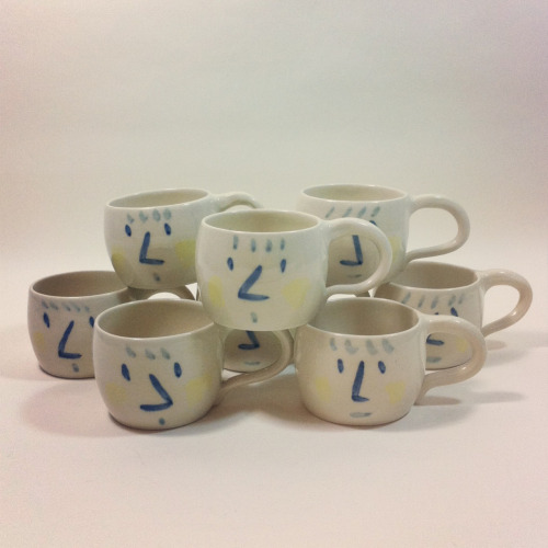 Pyramid of face mugs
