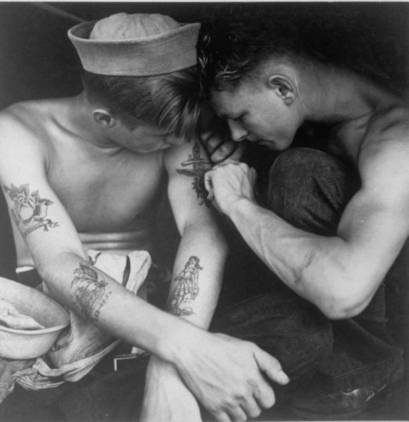 collective-history:  An American sailor having another tattoo done by a shipmate aboard the battleship USS New Jersey during WWII, 1944 by Charles Fenno Jacobs