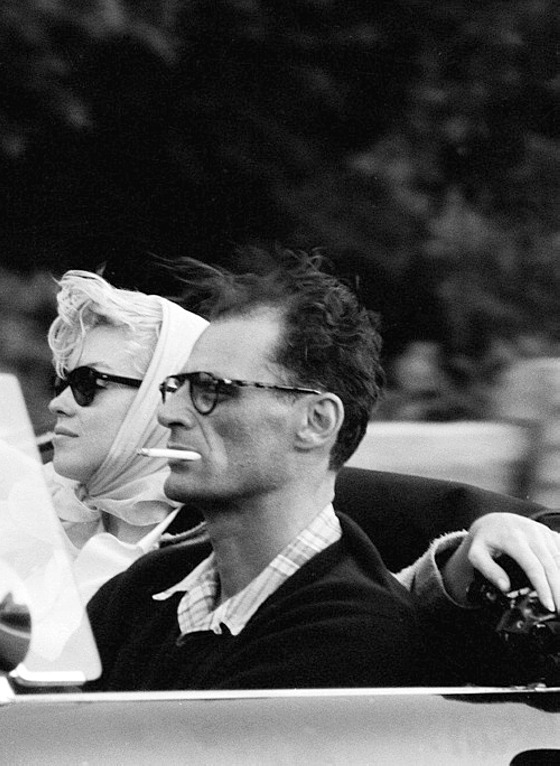 Marilyn Monroe and husband playwright Arthur Miller riding in their open convertible, 1957, photo by Sam Shaw