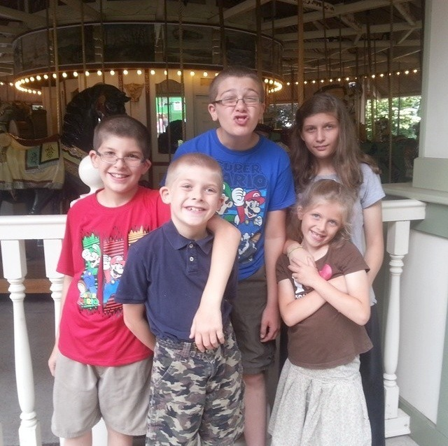 Look at how cute my family is! My parents took my youngest siblings to a local amusement park :)