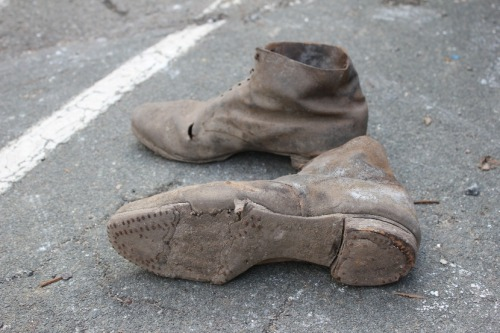 This pair of handmade boots was found under the floor at 57 Murray St. Similar concealed footwear has also been found at Woodbridge and the Royal George Hotel. Australian architectural historian Ian Evans has suggested that 'the use of personal items, such as shoes and garments with their close association with particular persons, served as lures to decoy evil beings into voids from which they could not escape.'