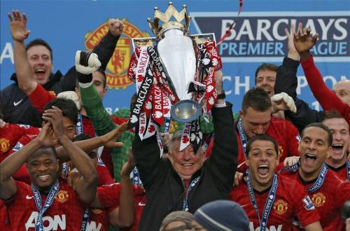 footballinframes:  Sir Alex Ferguson lifts the Premier League trophy for the 13th and final time as Manchester United manager.