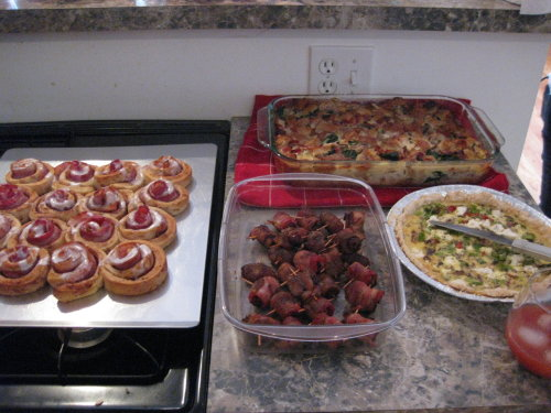 corzcooking:  Bacon Brunch: The Final Spread My bacon cinnamon rolls Carla and Alex's Bacon Wrapped Dates, (above the dates) Christina's Bacon, Spinach, Bread, Egg Casserole  ZOMG!  Good work!!
