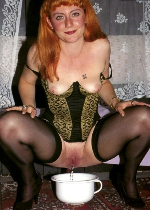 Lovely redhead has a piss….