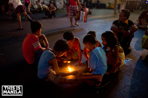 Children at Plaza Miranda on the night before the Feast of the Black Nazarene procession. January 8,2013|Quiapo, Manila