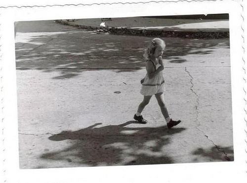 Little girl walking & eating ice cream cone. San Antonio, TX (1952)