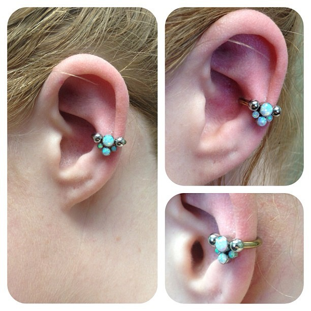 cjmaxwell:  This is a healed 12g conch piercing that I did a while back- today we popped in a snug fitting circular barbell (anodized bronze) with a white opal gem cluster from #anatometal to top it off! I'm pretty excited about how beautifully this fits her ear :) #saintsabrinas, #safepiercing, #conchpiercing #legitbodyjewelry, #piercing, #appmember