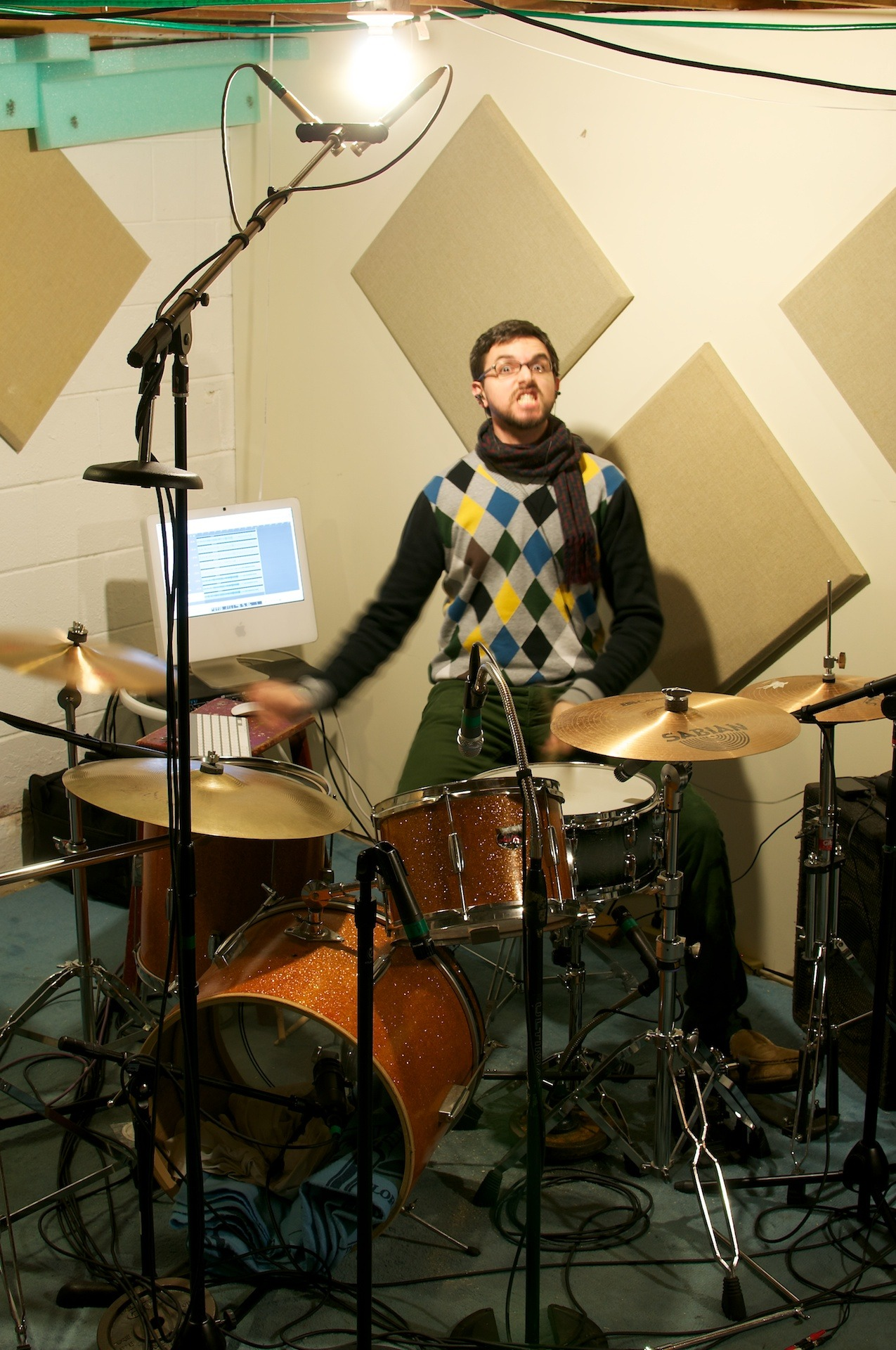 GPOYW It's hard to look like an angry drummer while wearing an argyle sweater and a warm scarf. EDIT: …and slippers.