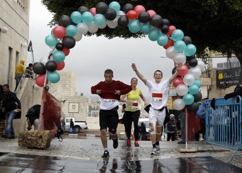 nbcnews:  First ever Palestinian marathon: Running to change West Bank's image (Photo: Ammar Awad / Reuters) BETHLEHEM, Israel — Jesus' traditional birthplace has long been linked to tensions between Israel and the Palestinians. On Sunday, around 1,000 athletes took a step towards transforming Bethlehem's modern image by running in the first official Palestinian marathon. Read the complete story.  Oh this is cool.