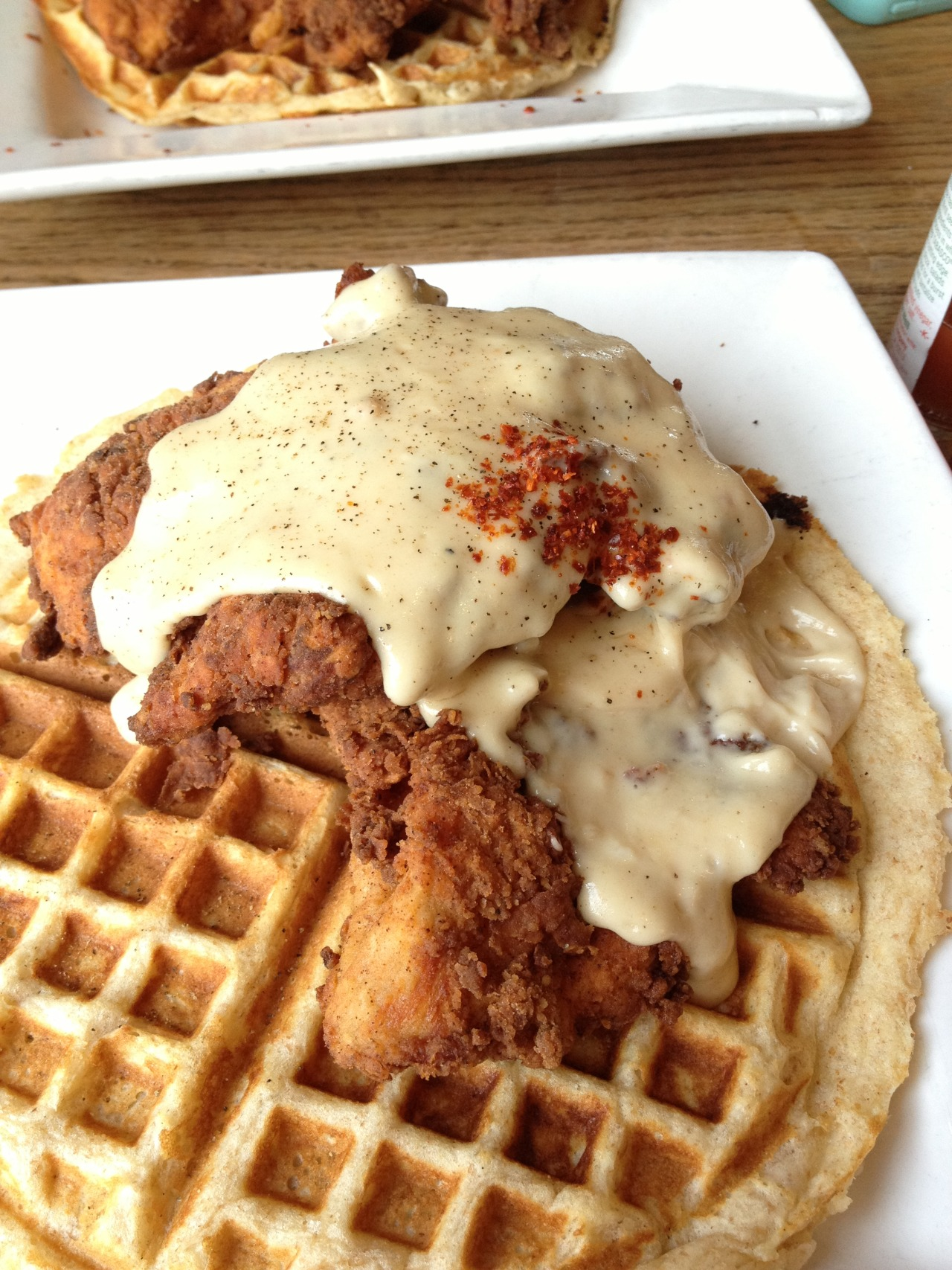 Chicken & Waffles! Finally got around to trying this recent obsession of food culture and I have to say it definitely lived up to all expectations. Went to 900 Grayson in Berkeley to try it out. Suggestion is to get both the gravy and maple syrup (my friend and I got each kind and split). The combination of sweet and salty is to die for! [Taken 2/16/13 at 900 Grayson in Berkeley, CA using iPhone 4S]