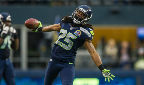 "On CBSSports.com NFL Top 100 Players, Richard Sherman lands at #9! ""He is cocky, brash and plays with a nasty edge. Oh, he can also cover. He had eight picks and led the league with 32 passes defended. He's damn good. Just ask him"" (Photo by Seattle Seahawks)"