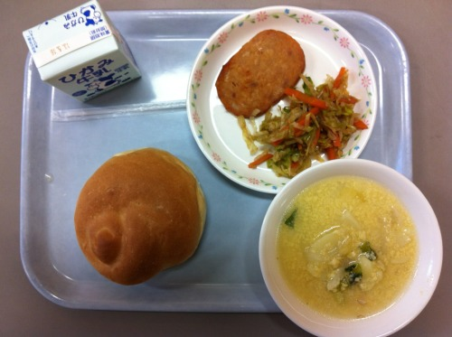 Today's school lunch: bread, fried ham/luncheon loaf, cabbage with a yakisoba sauce, and potato egg drop soup. I put the ham into the bread and made a sandwich. Yummy.