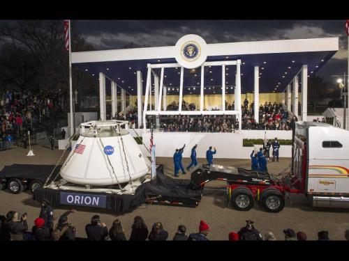 Orion in the Inaugural Parade The Orion space capsule along with NASA Astronauts Lee Morin, Alvin Drew, Kjell Lindgren, Serena Aunon, Kate Rubins, and Mike Massimino pass the Presidential viewing stand and President Barack Obama during the Inaugural Parade on Monday Jan. 21, 2013, in Washington, D.C. Orion will carry future astronauts beyond Earth orbit to farther destinations than ever before. Credit: NASA/Bill Ingalls