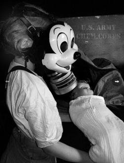 collectivehistory:  WWII era Mickey Mouse gas mask produced by the Sun Rubber Products Company.
