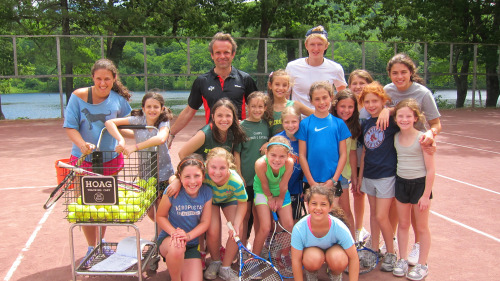 campers playing tennis at our co-ed summer camp