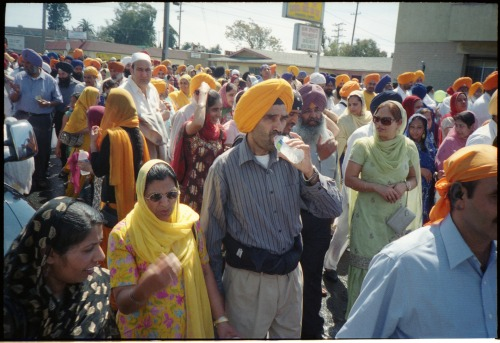 "SIKH PARADE - STOCKTON, CALIFORNIA  ""I just got back from the Sikh Parade,"" I tell my friends. ""The what?"" they say. ""The Sikh Parade. Starts near the beginning of San Joaquin Street, snakes through Downtown and across Weber, then back up California Street. Ya know?"" ""Never heard of it.""  I've attended the Sikh Parade for three years in a row now, and I maintain that it is one of the most enjoyable and liberating events that Stockton, California, has to offer its residents. Fresh, delicious Indian food is available on every street corner. Cultural music spills out of float speakers as they roll by. A wash of vibrant, colorful fabric streams through the street — collecting the bright spring sunlight and reflecting it against shop windows and the dashboards of parked cars. In 2012, the April parade preluded the October celebration of the 100th anniversary of the Stockton Gurdwara on South Grant Street. This temple is the first permanent Sikh settlement in the United States, and Sikhs from all over the California Central Valley come to visit and participate in the parade's progression through the city. The Sikh parade happens each year at the tail end of April.  * * * Brandon Getty is a State Guide to California, specifically the Central Valley region and his home city of Stockton. Follow on Tumblr at Maps to Stockton, on blogspot at Shooting Daggers, or on his Carbonmade Portfolio."