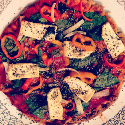 reblogged from yogioli:  Best. Pizza. Ever. Whole wheat pita, tomato sauce, spinach, peppers, lemon marinated tofu, onion, broccolini, oregano, pepper, basil 😍🍕