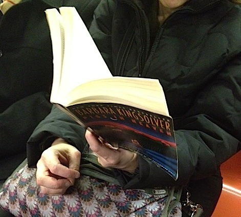 Seen on the Subway: Pigs in Heaven (in paperback) by Barbara Kingsolver.