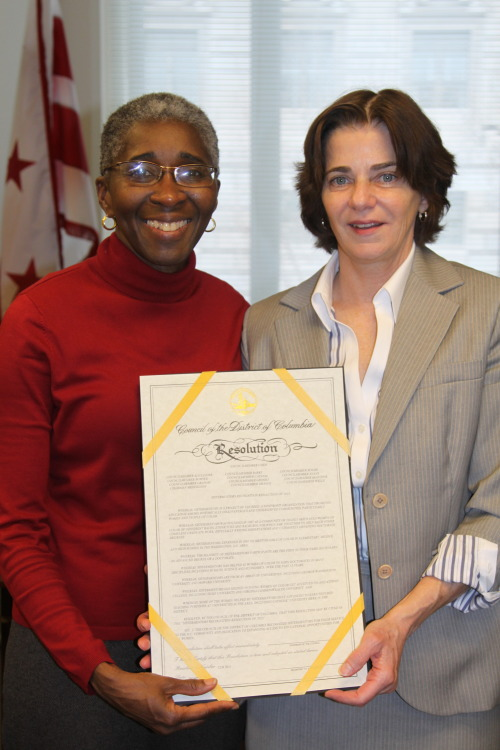 "Councilmember Cheh presents the ""SisterMentors Recognition Resolution of 2013"" to Dr. Shireen Lewis, the executive director of EduSeed, which administers the SisterMentors program. Founded in 1997, SisterMentors' mission is to promote education among traditionally disadvantaged and underserved communities such as women and people of color. SisterMentors mentors young women of color as they matriculate through college and graduate school. SisterMentors has helped 19 women through college and 42 women of color to earn doctorates."