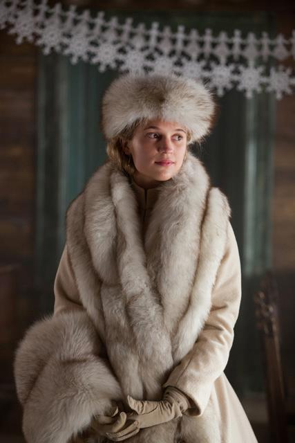 Anna Karenina - Alicia Vikander as Kitty wearing a cream coat with Mandarin collar and accessories (hat, stole and muff) made of fox fur.