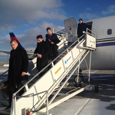 Horton, Marchand, Campbell and Lucic descend from the plane into a snow-covered #Toronto. #nhlbruins