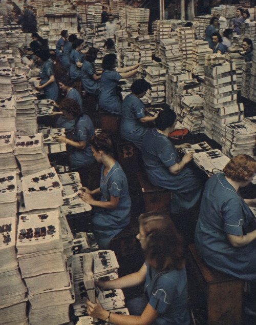 calumet412:  Assembling the Sears catalog…by hand!, 1942, Chicago. Torkel Korling