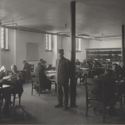 "Men's smoking room at Strathcona Public Library, Edmonton, Alberta, 1914. ""Apparently in 1914, it was believed that smoke wouldn't damage the books, but women might."""