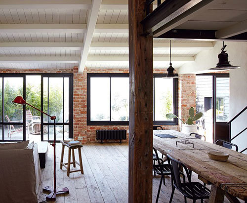 Exposed brick, reclaimed wood floors, steel mulls. Love the farm table.