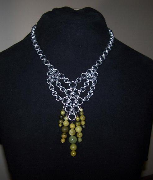 i made this necklace with 35 round jade beads of different sizes and galvanized steel jump rings that i made and cut….i can make adjust the length for you just let me know what size you would like it….other wise i will just send it as is….i will also add and hand made clasp / hook to keep it on…..if you have any questions please ask….also please message for postage outside the states….i have lots of earrings that would go super well with this necklace so check them out as well….