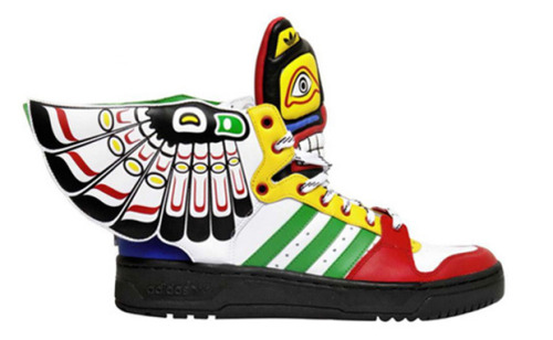 "ADIDAS ORIGINALS BY JEREMY SCOTT JS WINGS ""TOTEM""  With another out of this world pair of sneakers, designer Jeremy Scott may have completely topped himself with his ""Totem"" JS Wings. Loosely tied into a Native American iconography, his loudest pair for the Spring/Summer 2013 pair looks toward a totem pole for inspiration, and explores a wide variety of colors in its makeup. The adidas Originals Attitude high-top shoe sits on a black EVA midsole with a ton of Native tribal design work with a mock warrior face on the tongue. You can preorder the shoes at LUISAVIAROMA for about $270."
