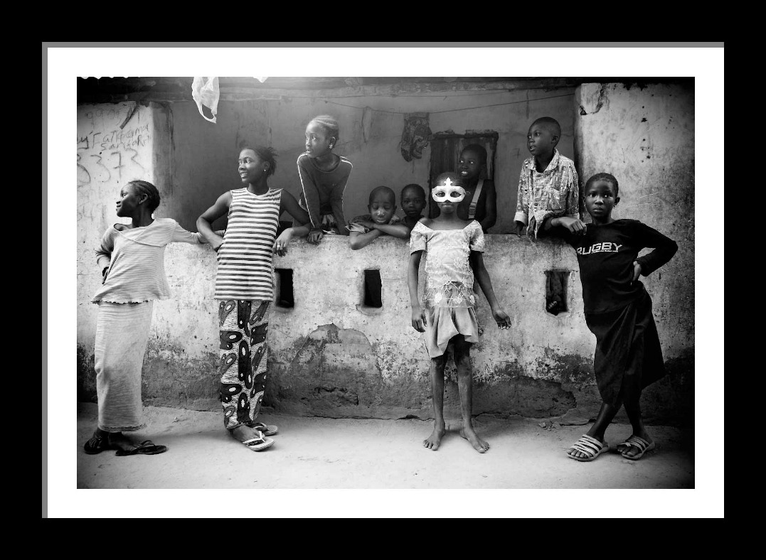 The girl in the mask - The Gambia, West Africa © Jason Florio. Limited edition fine art photography prints - b/w and color collections Fine Art Photography Prints Gallery - Jason Florio