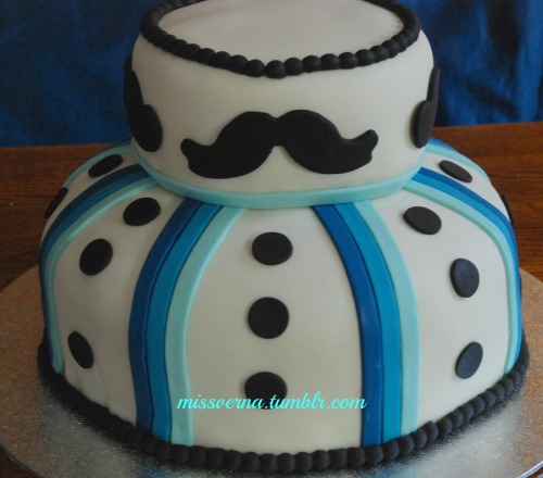 A dashing moustache cake if I might say. Looks like a tuxedo although I worried at first it looked like a snowman.