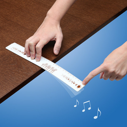 laughingsquid:  A Specially-Marked Ruler That You Flick Off the Edge of a Hard Surface to Play Musical Notes