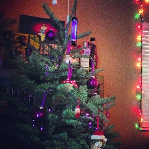 Mini black light on top of the party tree. Good idea @mikescreams (: #purple #christmas #tree