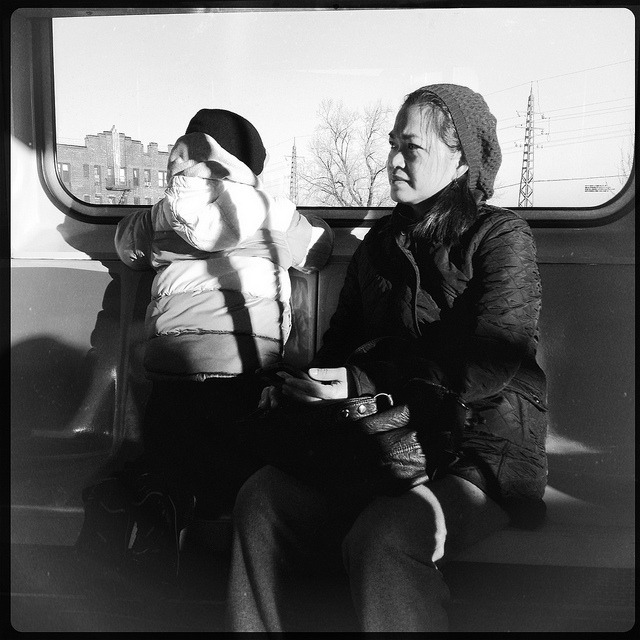 looking out the window. on Flickr.Mother and son on the 7 train. Kids love looking out the window, seeing the scenery changing as they pass by.