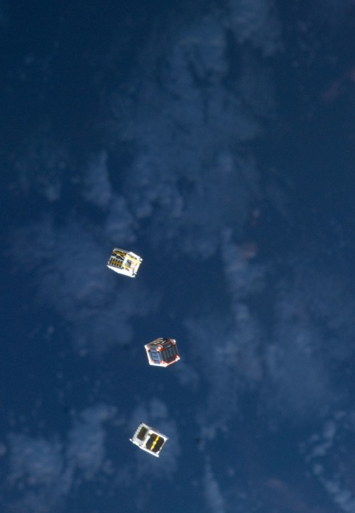 crookedindifference:  Several tiny satellites are featured in this image photographed by an Expedition 33 crew member on the International Space Station, on October 4, 2012. The satellites were released outside the Kibo laboratory using a Small Satellite Orbital Deployer attached to the Japanese module's robotic arm on October 4, 2012. Japan Aerospace Exploration Agency astronaut Aki Hoshide set up the satellite deployment gear inside the lab and placed it in the Kibo airlock. The Japanese robotic arm then grappled the deployment system and its satellites from the airlock for deployment.