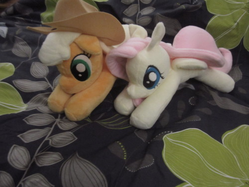 "So these two plushies are for sale. A Floppy Applejack and a Floppy Fluttershy plushie! They're about 14"" long, and about 7 or 8"" tall. They flop all gorgey over everything too :3  Applejack is $150 + shipping, and Fluttershy $125 + shipping. If you're interested in either, toss me an email!  You can get a hold of me at MLPponyplush@gmail.com"