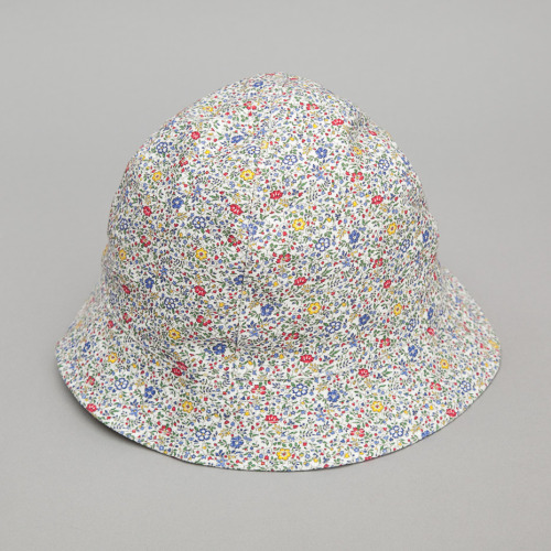 LIBERTY FLORAL BUCKET HAT BY YMC With the recent resurgence of bucket hats, we're thinking it would be a wise choice for you to drop everything you're doing and order one now.  Whoa man! Not right now!  At least humor me and finish reading this post.  After all, you never know what type of vital informative gold I could be saving for the knockout punch.  Like how this Liberty Floral Bucket Hat is the one you should buy.  Or how it has paneled construction and a fluted brim.  Or maybe even how 97 percent of all men that wear bucket hats live 10 years longer than those that don't.  Okay, that last statistic has no scientific backing but I had to make sure you were still paying attention.  Fine, now you can drop everything you're doing and order your bucket hat HERE. -Christian Lavery