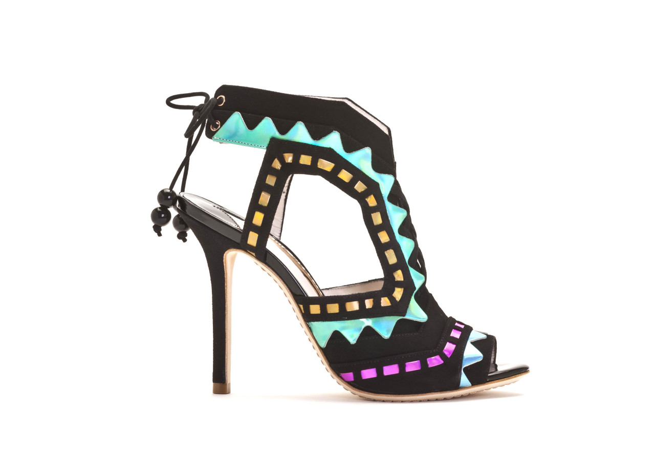 "SHOES THAT WILL MAKE YOU PRANCE Up close with Brit footwear designer Sophia Webster [[MORE]]  Photography courtesy Sophia Webster Words Martin Léon Hamery Sophia Webster decided that her favorite animal was a flamingo only after she discovered that unicorns weren't real. She has imbued her eponymous shoe line with that same longing to embrace the fantasy that lies within. Webster's Fall/Winter 2013 presentation at London fashion week resembled a magical polychromatic forest—or in her own words, ""a rainbow Narnia."" Resting against pastel-painted trees or atop oversized mushrooms, the models sported an eclectic range of footwear, from thigh-high sandals made of hologram leather to brightly colored metallic pumps with tribal zigzags. ""They're sexy and they're chic, but there's an element of fun,"" she comments on her quirky designs. ""Hopefully people see that as refreshing, you know?""  Webster was born in Durban, South Africa, where her mother's father had immigrated, but she grew up in Kent in South East England. In 2010, Webster graduated from the Royal College of Art, where she completed a Master's course in footwear. In her first year, she began assisting the acclaimed shoe designer Nicholas Kirkwood, where she came to admire her mentor's industrious approach to design: ""He's very focused, very driven. He really pushes the boundaries and if he has an idea, he'll always just go for it and won't give up until it's executed exactly how he wants it."" Now, two years later, Webster reflects on her recently launched label: ""I think Nicholas's shoes are very sexy, but maybe in more of an aggressive way, whereas mine are very sort of feminine and whimsical."" She says she designs for women who ""don't take themselves too seriously,"" naming Vogue Japan's editor at large Anna Dello Russo as an ideal client. ""You know she's just sort of the ultimate in extravagance and luxury,"" she adds.   With her shoes springing up in retailers across the globe—Dover Street Market, Harvey Nichols, David Jones, Colette, and Bergdorf Goodman, to name a few, Webster's next move will be to open her own store (she says the first one would have to be in London). ""I'd love to have sort of gone into different product categories,"" she adds, ""but for now I'm just trying to take each day as it comes really. Trying not to run before I can walk."""